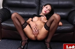 Classy ladyboy jerks off and shows her ass