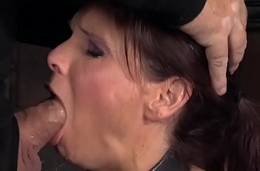 BDSM milf drooling while being throated